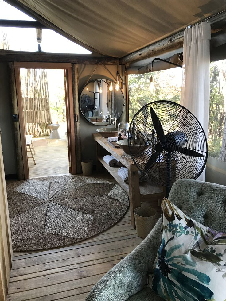 Bathroom on suite with an outside shower and bath with views of the African bush.