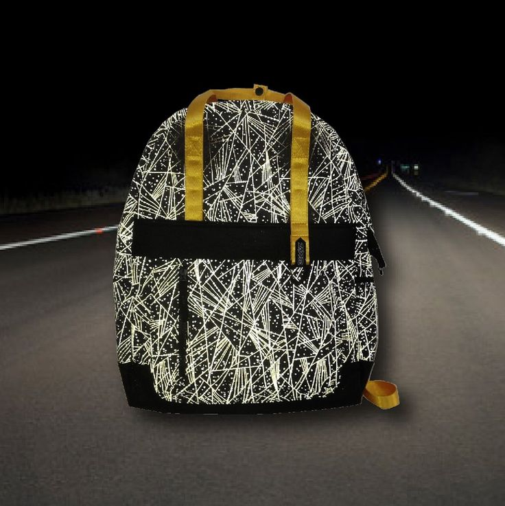 The Back Pack. Our insanely cool yet simple backpack does everything while remaining super chill. Made from the highest quality reflective pattern printing technology, it stays low key during the day and throws a party when hit by light at night!