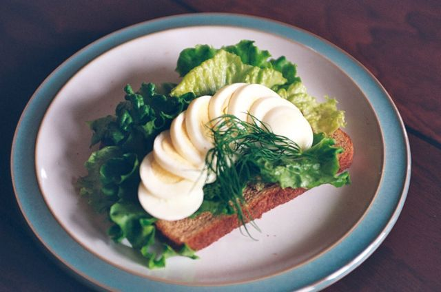 Nordic Flavor Inspiration: Smørrebrødwith Anchovy-Dill Butter, Green Leaf Lettuce, and a Hard-Boiled Egg