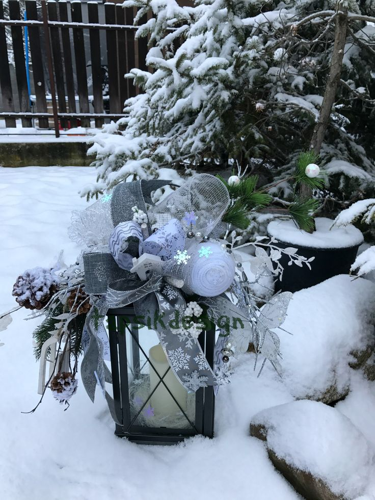 Winter Lantern decoration. Added different kinds of tree branches, funky bow, sledge, handmade snowball, bead garland, owl, butterfly and lots of small decor. Lantern around 45 cm.