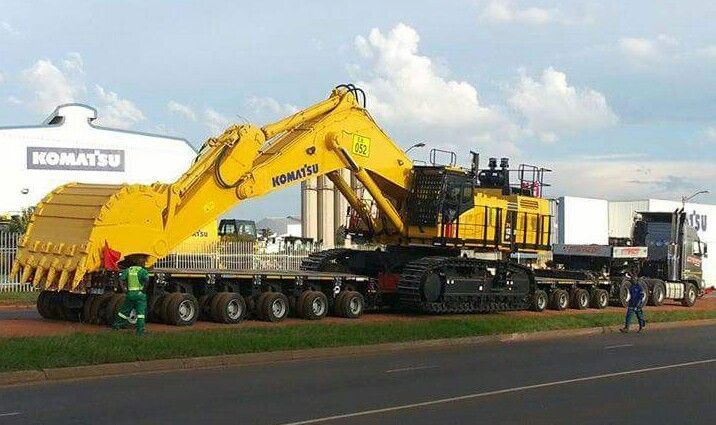 komatsu pc1250 being moved in one piece the heavy team