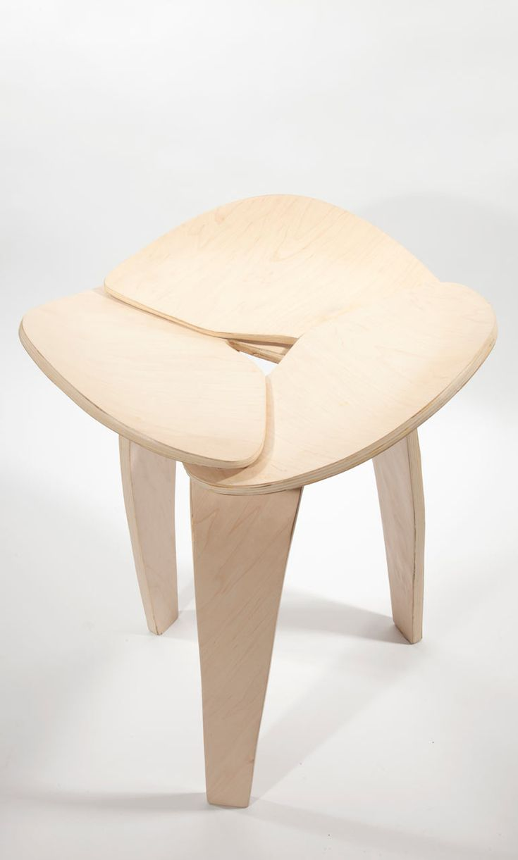 Bent Plywood Chair - A sculptural stool made of three symmetrical pieces of bent plywood that connect together into a
