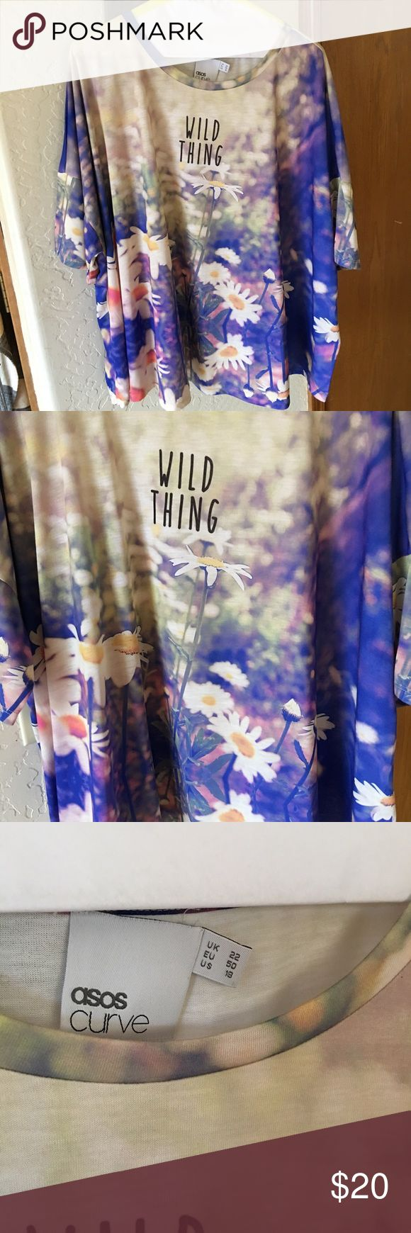 """'Wild Thing' Floral ASOS Curve Top Never before worn, this boxy tee is so cute on. It's the best way to take a basic t-shirt and spice it up with some floral notes. The print is very lifelike, and it adds and extra something to the top. The little bit of text """"wild thing"""" is completely on trend right now. Works best over jeans, but if you have white pants - it would look spectacular! ASOS Curve Tops Tees - Short Sleeve"""