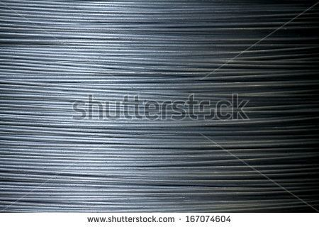 Texture of steel wire in a coil - stock photo