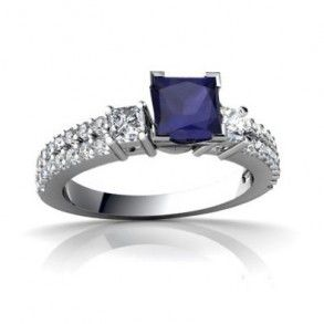 Square Genuine Blue Sapphire Diamond Engagement Ring - This is where stylish meets contemporary with this flawless 14k White Gold Square Genuine Blue Sapphire Diamond Engagement Ring that's placed in a 4 Prong setting featuring a Dark Blue cut center stone with White Round  Princess cut accent stones. The Square Genuine Blue Sapphire engagement ring's total gem weight is equal to .90 carats  all of the diamonds are 100% natural. #unusualengagementrings