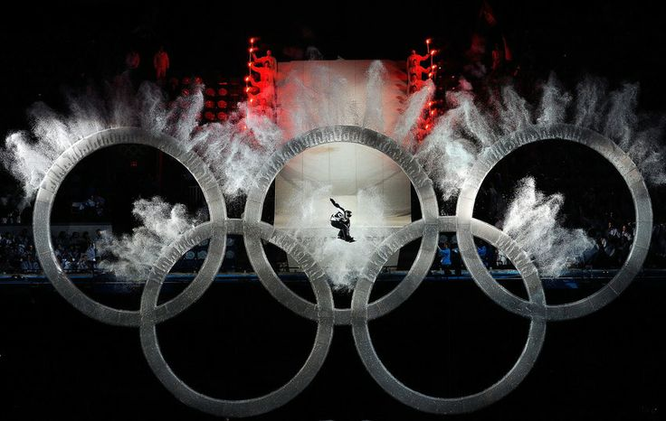 Historic Winter Olympics Photos We'll Never Forget A snowboarder flies though the Olympic rings during the opening ceremony of the Vancouver Winter Olympics on Feb. 12, 2010. IMAGE: KEVORK DJANSEZIAN/GETTY IMAGES