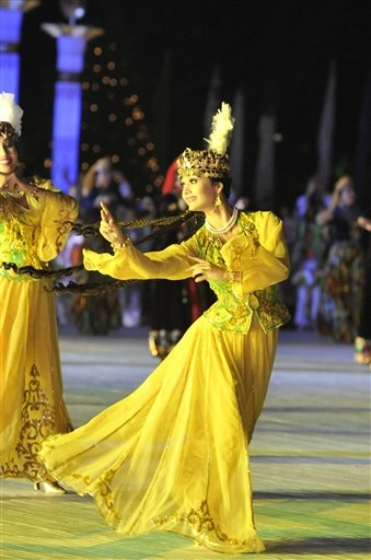 Women, wearing traditional Uzbek costumes, dance during an official celebration to mark Independence Day in Tashkent, Uzbekistan. The 1st of September is independence day in Uzbekistan. It is the most important public holiday of the country. (V)