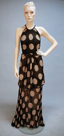 this dress shows rhythm simply through the repeating polka dot pattern.