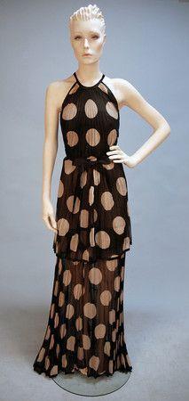 this dress shows rhythm simply through the repeating polka dot pattern.