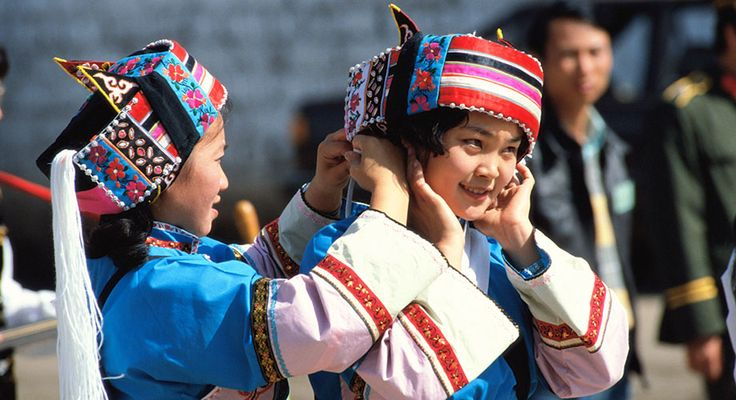 Local girls try on the ancient robes of Kunming, capital of the Yunnan Province.