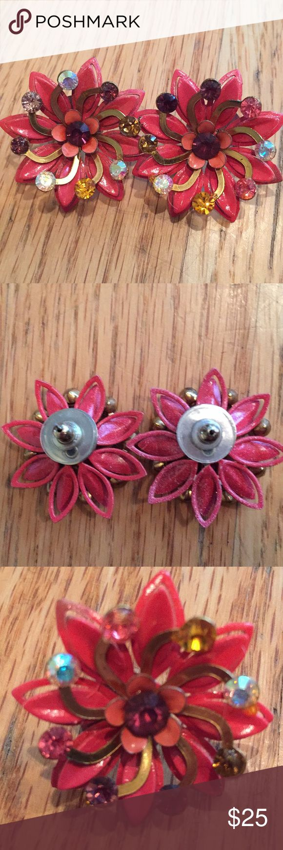 Gorgeous metal pink earrings Gorgeous metal pink earrings with Swarovski crystals. For pierced ears. Has center red crystal and red yellow and white crystals on petals. Jewelry Earrings