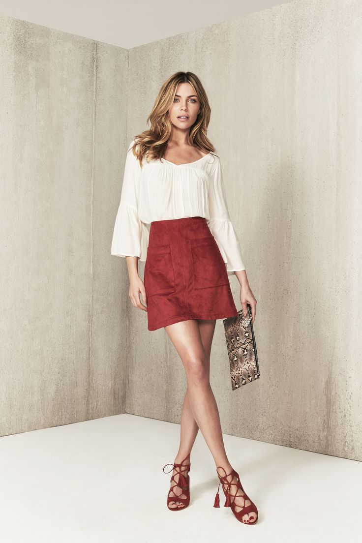 Bring back 70s style with this flirty boho blouse & suede combo, as styled by Abbey Clancy