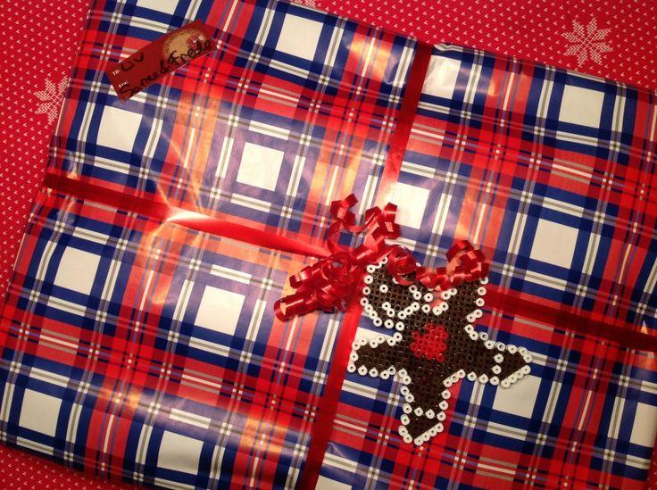 Christmas present wrapping idea. Hama perler beads gingerbreadman.
