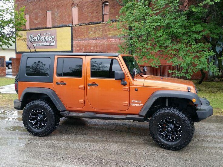 2010 Jeep Wrangler, Mango Tango Orange, 4 in lift, 17x9 Fuel Assualt Wheels