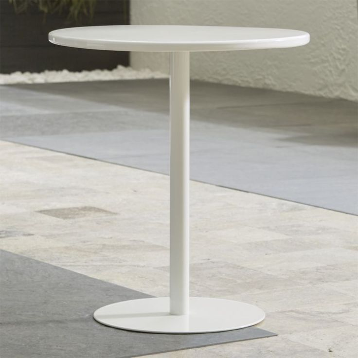 Shop Spot White Side Table.  This neat pedestal table pulls up alongside a sofa or between lounge chairs to park a drink, and add a spot of bright white.