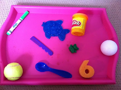 The Missing Object game?  It uses Sight and Memory. Make a tray of objects, have the child study them and then have the child close her eyes or turn around so they don't see the tray anymore.  Then take one item again and hide it, ask the child to come back and look and she has to guess which item is now missing from the tray.