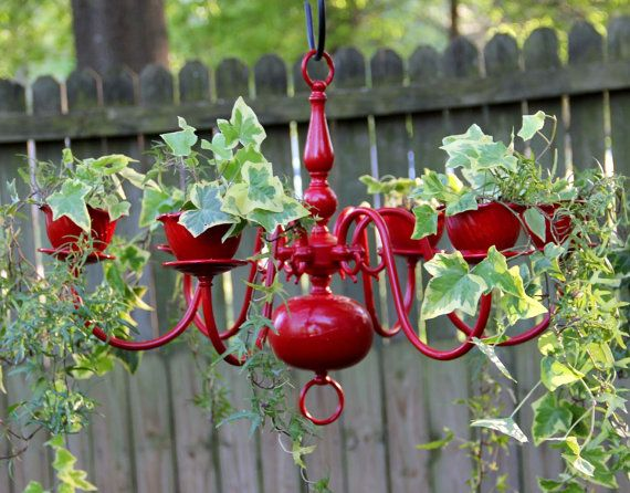Repurposed old chandelier painted red and planted with ivy #gardenartproject #diy #recycled