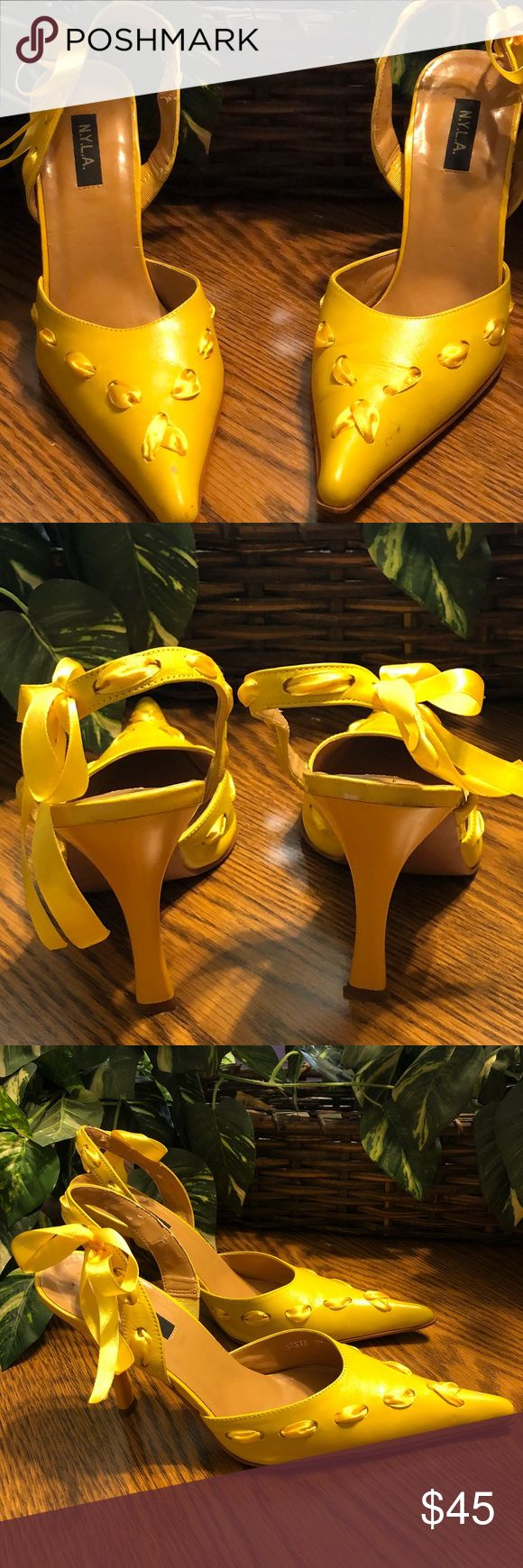 N.Y.L.A. Yellow Threaded Ribbon Shoes, Size 9 These are a lovely pair of yellow N.Y.L.A. Brand ladies heels. These beauties have yellow ribbon interwoven through out the shoe, ending with a beautiful ribbon on the side of the shoe. They have a three-inch heel and a back ankle strap design. This is a US size 9 shoe.   ✨There are two very small scuff marks (one on each shoe). A photo has been taken up close and far away to show how the mark looks. Please check our photos. ✨ N.Y.L.A. Shoes…