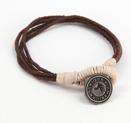 "This wristband features intertwined leather straps, sisal detailing, and a pewter-tone medallion inscribed with ""For God Remembers Still.""  *Wristband comes with medallion inscribed with ""For God Remembers Still"" and not with ""Unique American"" as shown in the picture."