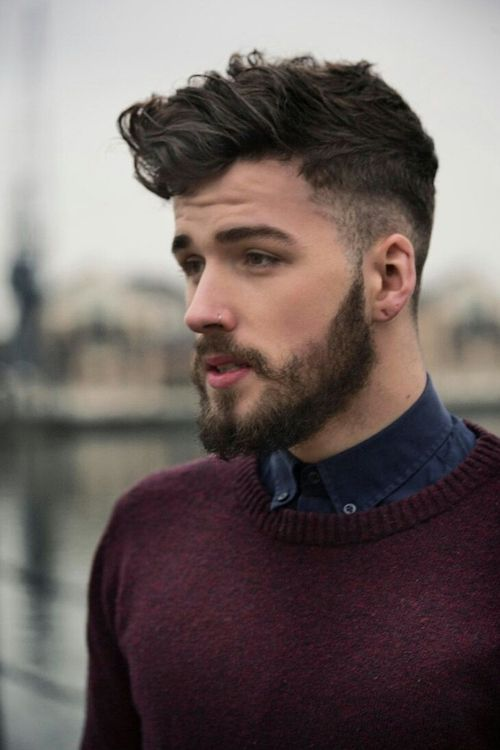 Male model with hair buzzed on the sides and longer on top