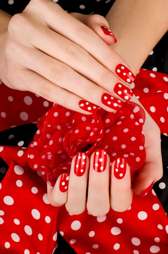 Red manicure with white dots