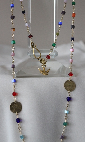 Colourful beaded necklace with golden wire and dangling charm.
