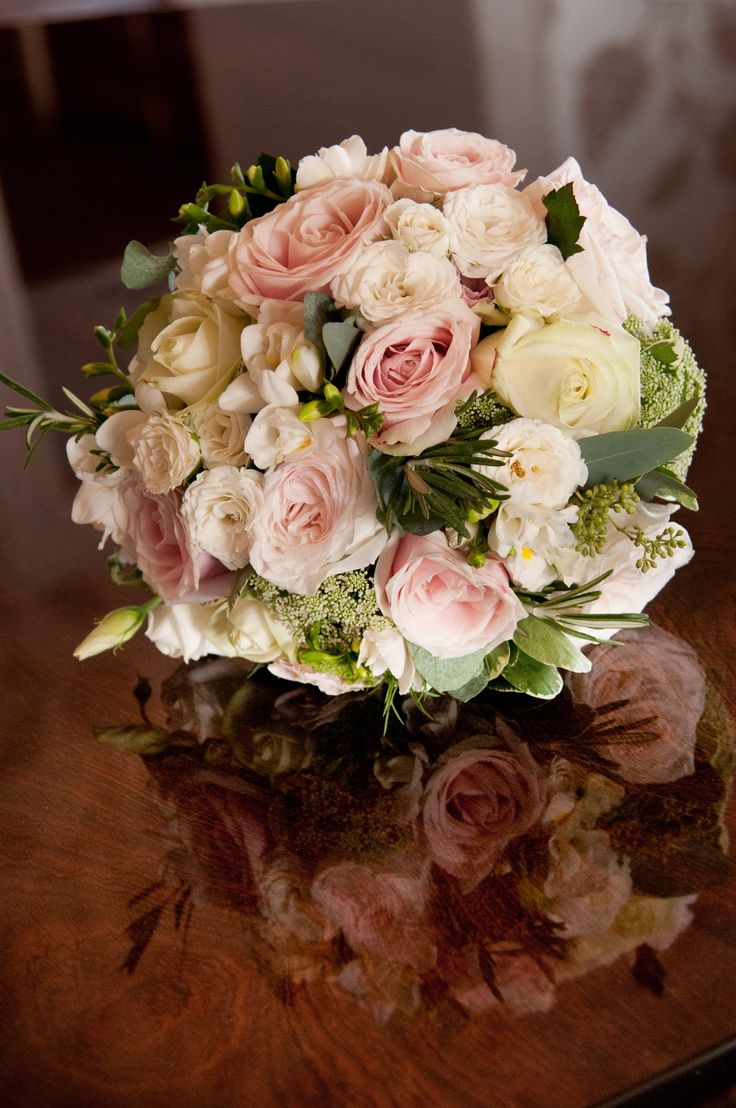 Bridal bouquet at Froyle Park. Image taken by Lawrence Photography flowers by Eden Blooms. Avalanche, Sweet Avalanche, White O'Hara roses, Rosemary, Spray roses and Freesia
