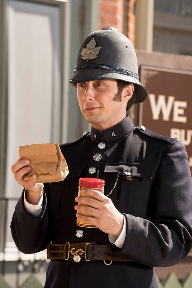 Constable Crabtree (Jonny Harris) accepts the bag of evidence from Louise Cherry.