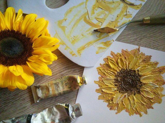 Eliza painting sunflowers.