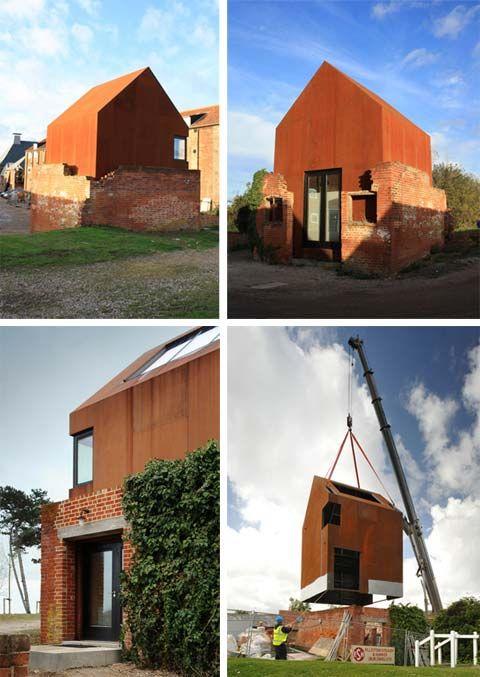 Prefab corten-steel studio seems to be growing out of the original brickwork ruins Snape Maltings, Suffolk.