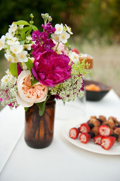 Floral Centrepiece - in a simple but effective brown bottle!
