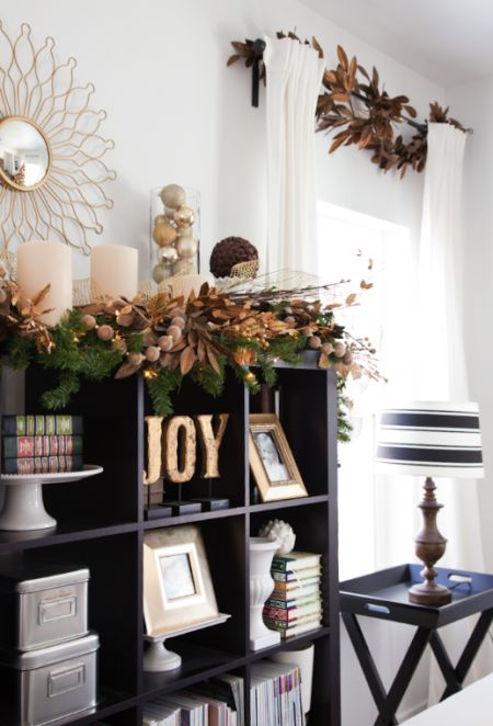 love the leaves added to the curtain rod to create a more comprehensive christmas look shelf decorationsgold