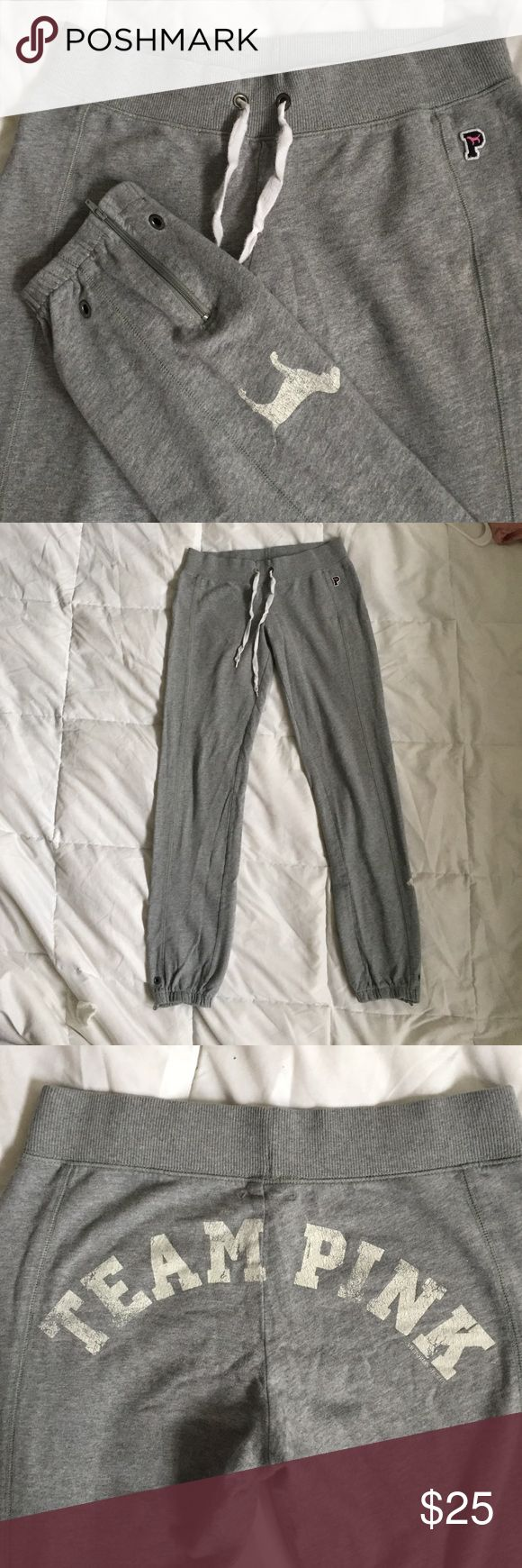 Victoria's Secret Team Pink Gray Sweatpants Barely worn VS secret gray slim fit sweatpants, size XS fits Small and a snug medium (had my friend who's a Medium because of big hip area try it on & fits her fine but snug on hips)  Has the logo and the dog - letters are faded (design) no rips or tears, only thing upon close inspection is a small barely visible stain on picture. Zipper at the ankles 👖 Victoria's Secret Pants Track Pants & Joggers