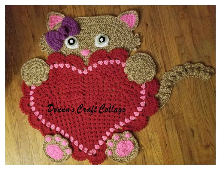 Sassy the Kitty Heart Rug by Donna's Craft Collage can be purchased from --> https://www.etsy.com/ca/listing/511833523/kitty-cat-crochet-heart-rug-ready-to?ref=shop_home_active_1  Crochet Pattern from --> https://irarott.com/Kitty_Cat_Heart_Rug_Crochet_Pattern.html