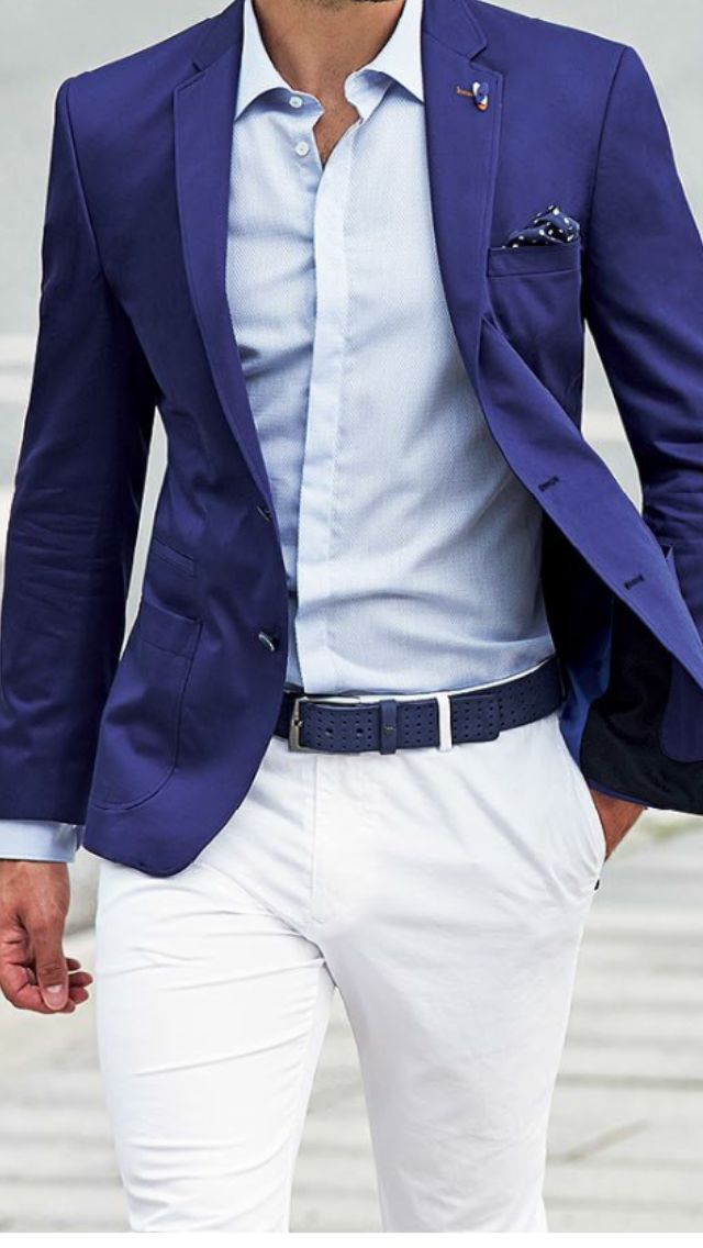 A bright blue blazer with white pants, a white shirt, and a pocket square accent.