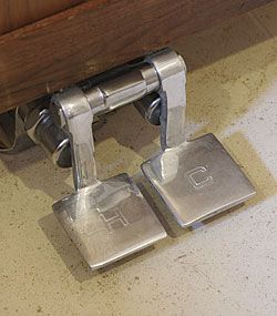 Two pedals (one for hot water, one for cold) control each faucet.