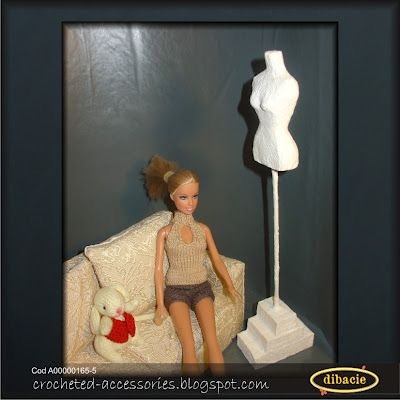 a papier mache Barbie torso