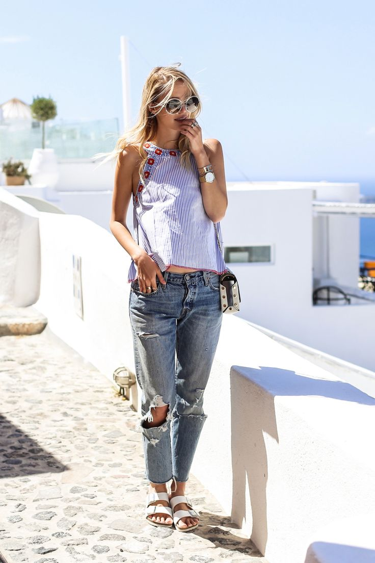 Blogger Leonie Hanne of ohhcouture looks great in a Tory Burch top  traveling in Santorini