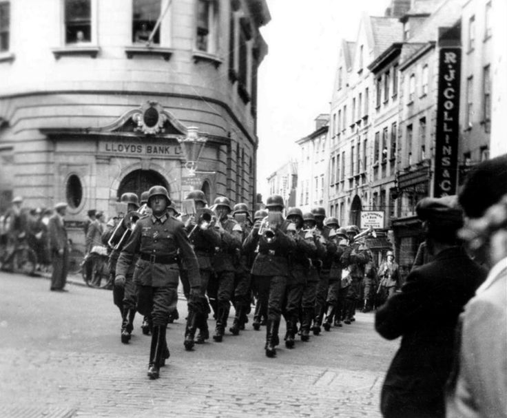 German soldiers parade through the High Street of St. Peter Port on the British island of Guernsey. By 4 July 1940, all eight inhabited islands that make up the Channel Islands were...