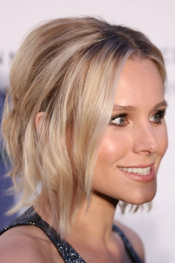 Turn second-day hair into styling magic with a half pony like Kristen Bell