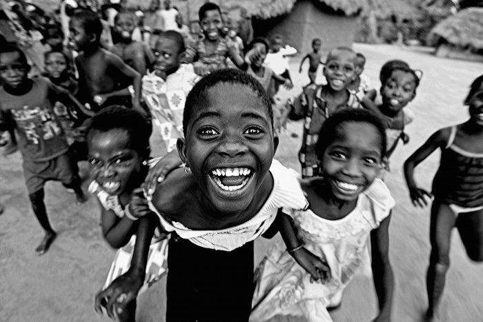 Ghana. Shout of happiness in a small village in countryside of Ghana.