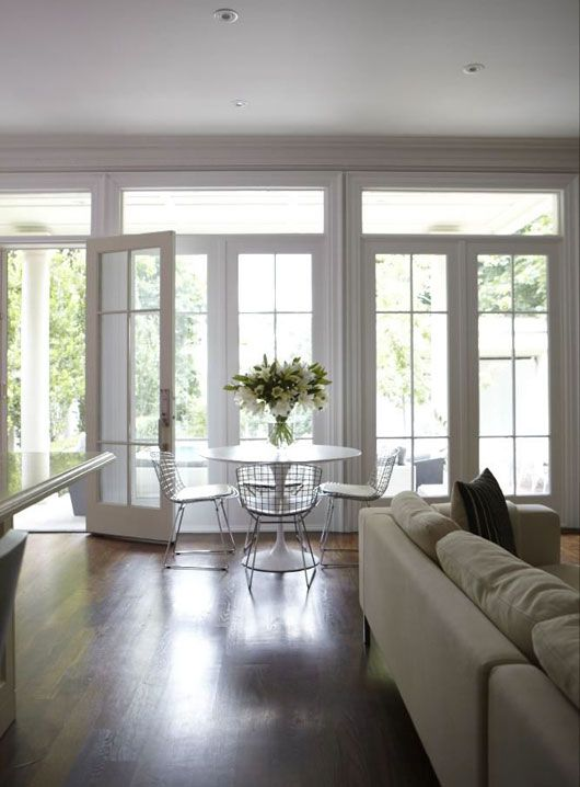 Suzie: HGTV - Wall of French doors & transom windows, Marble Saarinen Dining Table and Bertoia ...
