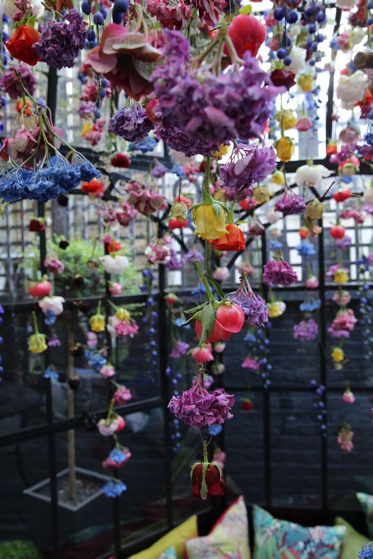 Tumbling, falling flowers by Rebecca Louise Law in the space co-designed with Matthew Williamson at Blakes Hotel in London