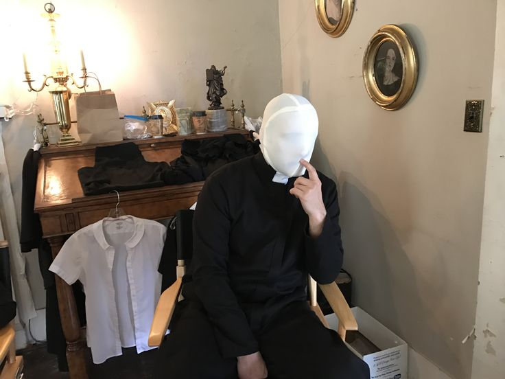 Faceless priest in nuns clothing