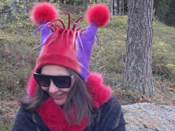 Hand felted and hand dyed hat decorated with fox pompons