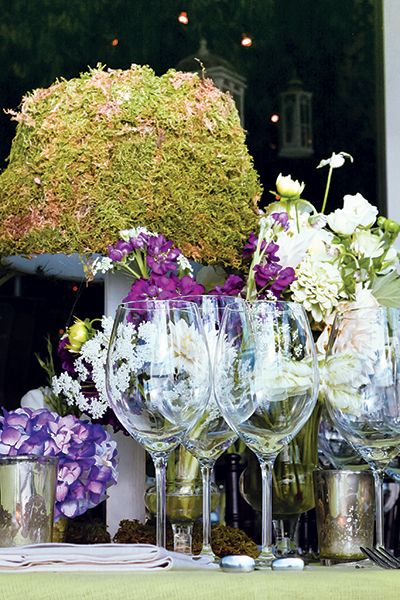 Stone Kelly Events pairs tender blooms with moss to evoke a woodland fantasy.Photo Credit: Amy Doyle