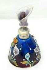 Perfume bottle decorated with calla lilies it is an art