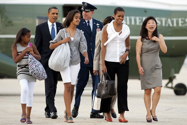 The Stunning Style Transformation Of Malia Obama. President Obama & Family deplaning Air Force One accompanied by entourage..