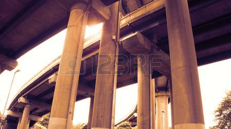 Curved highway elevated on concrete pillars from a low angle