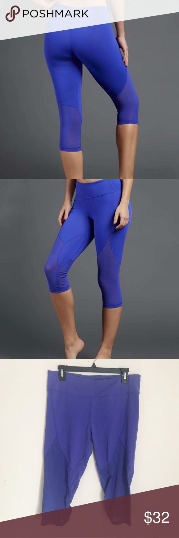Royal Blue Mesh-Contrast Capri Leggings XL Hit the track or the yoga mat with confidence in these breathable, stretch-blend leggings that conform to your curves to keep you comfortable whether you're coming up on mile five or perfecting your downward dog.  In very good condition size XL stretchable  83% nylon / 17% spandex Machine wash Imported  Retail $54 Zobha Pants Capris